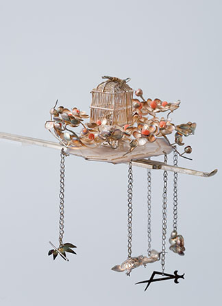 Ornamental hairpin with fan, plum blossoms and bird cage design and hanging decoration. Gold, silver and coral.